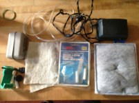 A pump, charcoal filters, tubing, magnetic glass wall cleaner, cleaning pads. Who want them? FREECYLE.