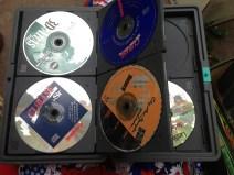 12 defunct computer game discs. TRASH.