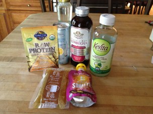 "This ""health"" food was left by a client. Ironically she was here for some kind of relationships to food conference. The fridge was full of partially eaten taken out. These, however, remained intact. None of this qualifies as food in my mind. And kombucha tastes like ass. I dropped it off at APEX where someone surely will snap this faddy shit up."