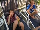 Boys snacking on their own
