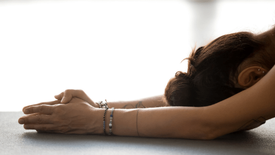 woman setting intention during yoga