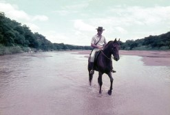 Gordon and his horse in river