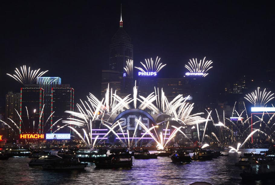 Fireworks explode at the Hong Kong Convention and Exhibition Center over Victoria Harbour to celebrate the New Year, on January 1, 2013