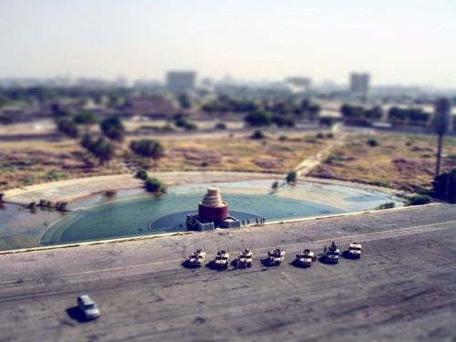 Taken sometime in 2006.  #tiltshift of a parking lot and the Baghdad skyline. Don't remember where this was taken exactly -- I remember climbing a tower though. May have been at the #crossedsabres. Those are our Humvees down there.  #photography #photographer #amateurphotography #amateurphotographer #iraq #baghdad #oif #operarioniraqifreedom #warphotography #iraqwarphotography