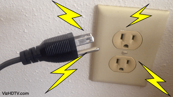 Vizio TV power cord plugging into a power outlet.