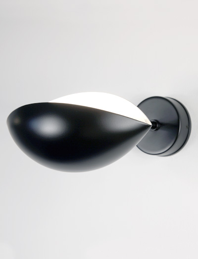 "The Mouille ""œil"" or Eye Sconce is named for the shape of the shade. Designed by Mouille in 1953."