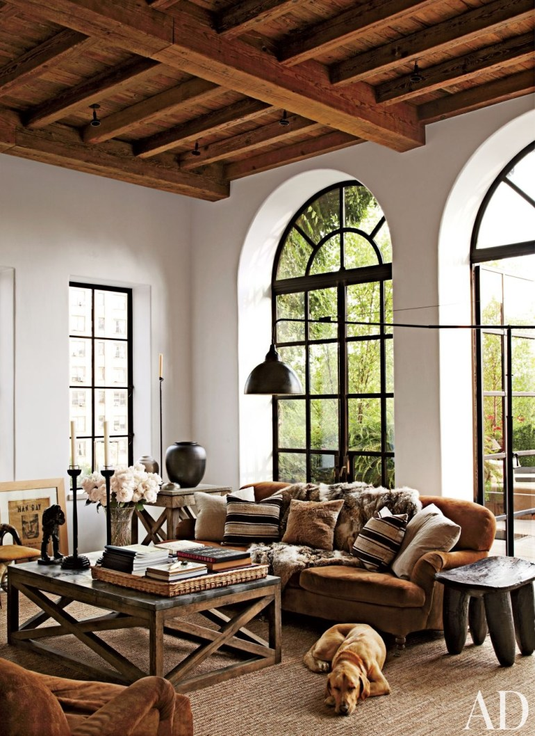 Steel windows incorporated in a rustic farmhouse, via Architectural Digest