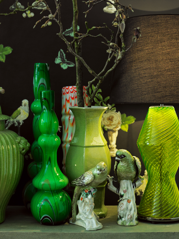 Green collection of glass and porcelain vases and some beautiful birds, styled by Annabell Kutucu - via Villa Harteneck