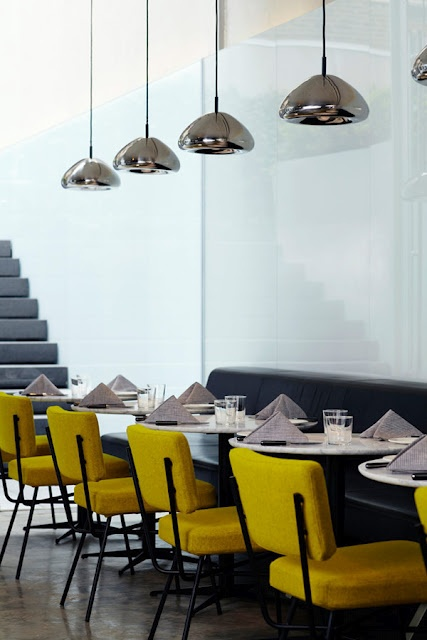 New York Hotel Americano's dining room with mustard chairs, by French designer Arnaud Montigny - via Mariana Vieira