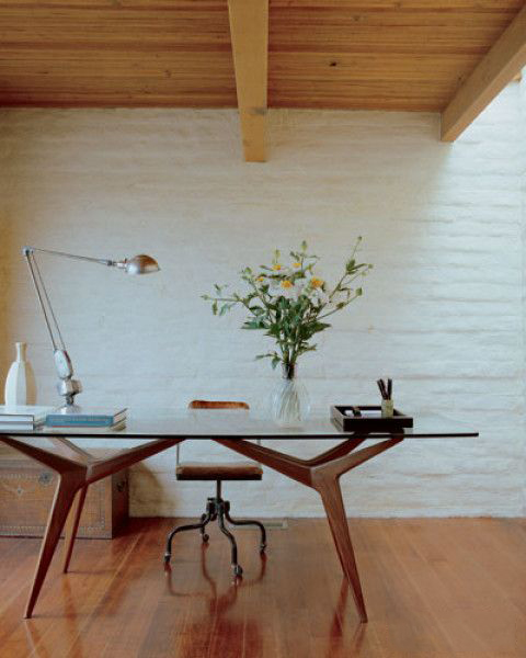 Vintage glass-top table used as a desk by Californian interior designer Michael S. Smith - via Elle Decor