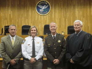 Commonwealth Attorney Tom Bowers, Chief Deputy April Staton, Sheriff Ric Atkins, and Judge Charles Dorsey gather together after the ceremony.