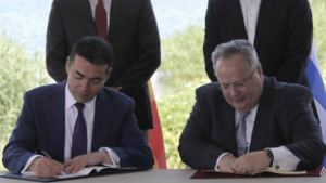 Macedonian and Greek Ministers for foreign affairs, Nikola Dimitrov and Nikos Kotzias, signing the agreement on name issue