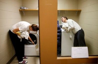 Jennie Lansberry (left) and Alyssa Dodson change over loads of laundry at the Chesterfield County Jail on Oct. 19, 2016. They are part of an opioid program in the jail.