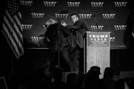 After somebody in the crowd yelled 'gun' while scuffling with a protester, US Secret Service agents rush Donald J. Trump offstage amid a chaotic scene at a campaign rally Saturday, Nov. 5, 2016 at the Reno-Sparks Convention Center in Reno, NV. No gun was ever recovered and the protester was not charged for any crime.