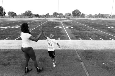 "Tia Watkins plays with her son, Shawn Watkins Jr. before her football practice with the D.C. Divas at Spingarn High School on Wednesday July 20, 2016 in Washington, DC. The D.C. Divas is a full-contact female football team. Among the things that motivate her to play a sport not widely known as a women's sport is the role model she can provide for her children. ""Having a son, I'm showing him to respect women and that women can do anything you can do."" For her daughter Tia believes that having Jori watch her play football will result in her having a greater ""sense of self"" as well as ""increasing her confidence and just showing her that I can be whatever I want to be , even if it's not playing football. If I want to be President of the United States or the CEO of a company, there's no limits."""