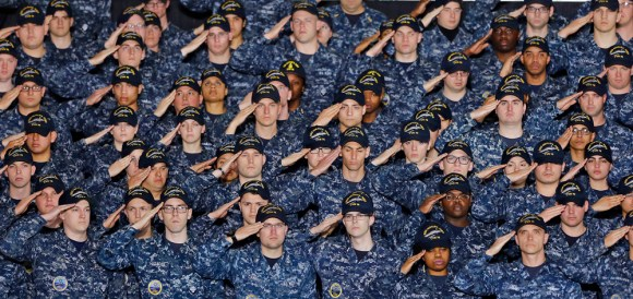 Members of the Navy salute before President Donald Trump speaks abroad the aircraft carrier Gerald R. Ford CVN-78 at Newport News Shipbuilding Thursday afternoon March 2, 2017.