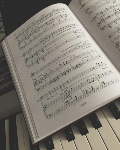 Italian sheet music on piano, used by a vocal coach.