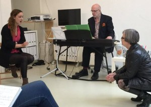 Dr Gillyanne Kayes and Jeremy Fisher working together with a singer