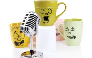 Friendly cartoon mug singing into mic with horror-stricken mugs listening