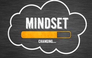 "A cloud with ""mindset changing"" written and a progress indicator"