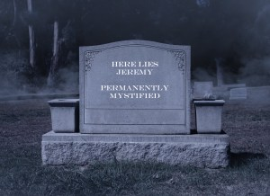 """Gravestone in a cemetary with the inscription """"Here lies Jeremy, permanently mystified""""."""