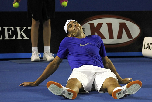 """Nadal reacts during the fundraising exhibition """"Hit for Haiti"""" ahead of the Australian Open in Melbourne"""