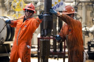 Workers change a drill pipe on the Laurus oil drilling rig operated by Petroleos Mexicans (Pemex) in the Ku-Maloob-Zaap oilfield at Campeche Bay off the coast of Ciudad del Carmen, Mexico, on Friday, Aug. 1, 2014. Mexico's Senate is scheduled to hold a vote tonight on the final measure to implement the constitutional overhaul approved in December ending Pemex's exclusive right to crude oil production, now in its 76th year. Photographer: Susana Gonzalez/Bloomberg