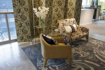 Armchair, screen and cushion upholstered in the 'Splendour' fabric and wallpaper in 'Gold'
