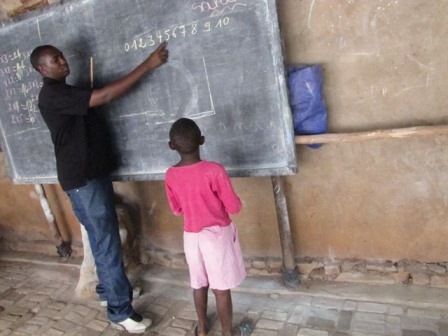 cyriaque teaching young girl