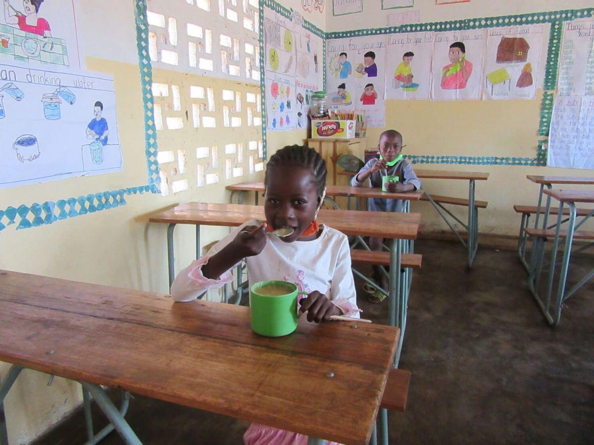 VOH Luongo child eating porridge