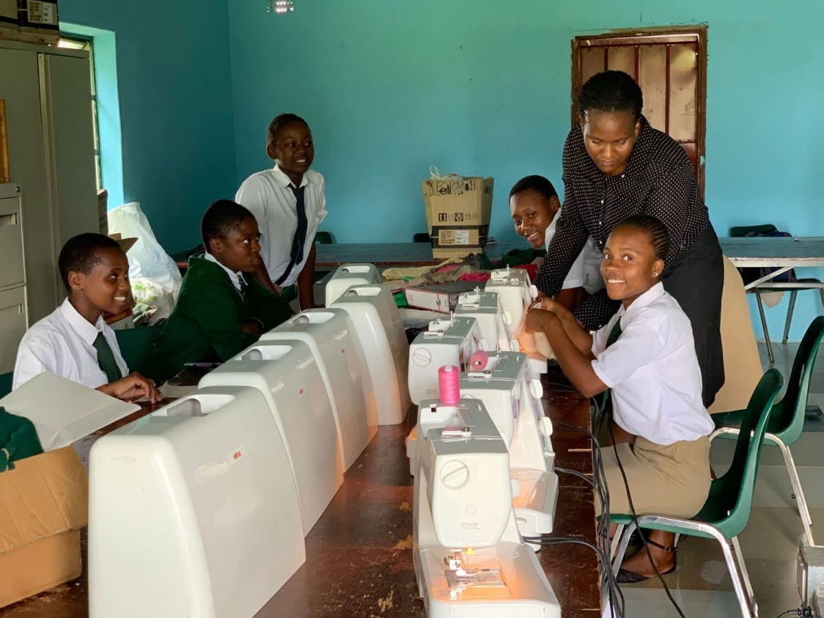 youth learning to sew