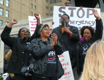 Marchers from the National Action Network cheer as Rev. Chas. Williams II speaks.