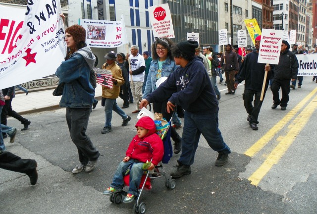 Babies and youth take the march back down Woodward.
