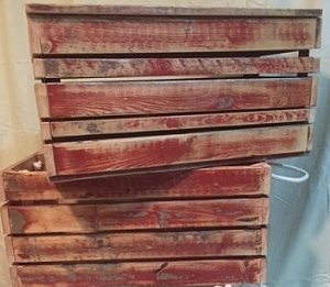 red-grey crates with natural patina from weather and time