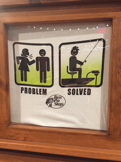 """T shirt shows a stick figure woman yelling at a stick figure man. Underneath it says """"problem"""". In the next box the stick figure man is fishing. Underneath it says """"solution""""."""