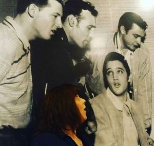 I'm pretending to harmonize in the famous photo of Jerry Lee, Carl, Elvis and Johnny on the wall of Sun Studio