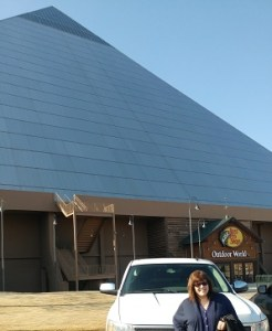 Me in front of our white pick-up with the shiny Bass Pro pyramid buidling in the background