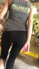 photo of a woman's backside as she wears yoga pants with a t-shirt