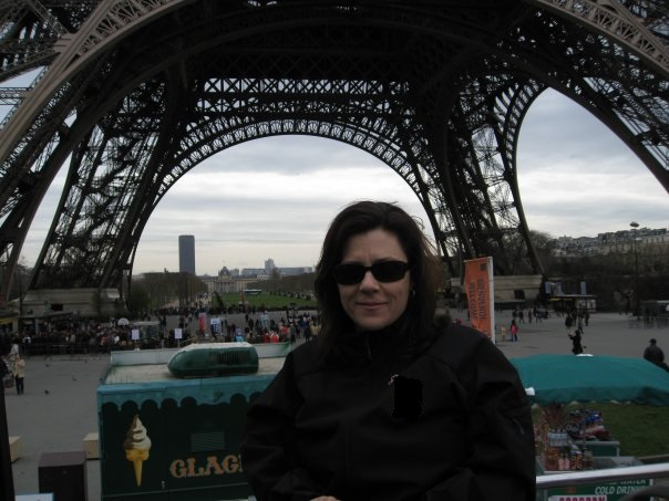 me in the foreground with the base of the Eiffel tower behind me