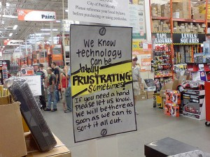 photo of hand-written sign at a Home Depot reads: We know technology can be frustrating sometimes. If you need a hand please let us know. We will be there as soon as we can to sort it all out.