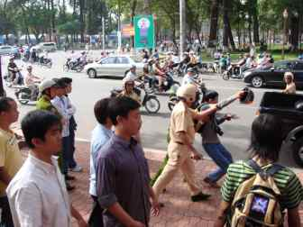 One of several times Vietnamese uniformed and undercover police surrounded and picked up Dieu Cay as he led protest marches in downtown Saigon, now named Ho Chi Minh City. (Photo courtesy Dieu Cay)