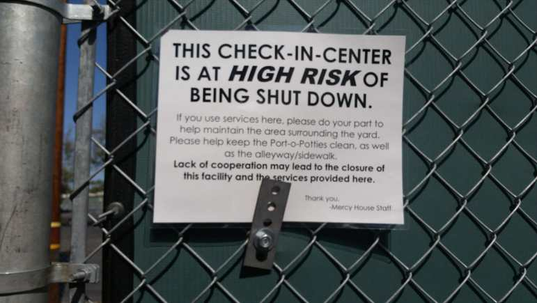 Mercy House check-in sign - shut down