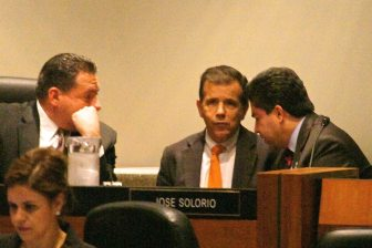 Pulido (center) huddles with Villegas (left) and Solorio just after the closed session vote on appealing Sontag's reinstatement. (Photo by Nick Gerda)