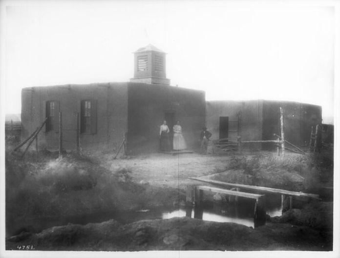School house at the pueblo of San Rafael, New Mexico, ca.1900. Via Wikimedia Commons.