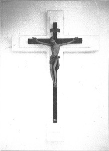 The original crucifix in the church with the new stucco backdrop built during the renovation. The crucifix is completely carved wood.