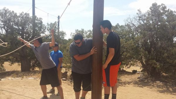 Newman Club students enjoy a day at an adventure ropes course.
