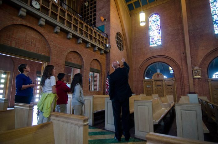 Deborah Miller, left, and her students receive a personal tour of the Cathedral from Bishop Wall.