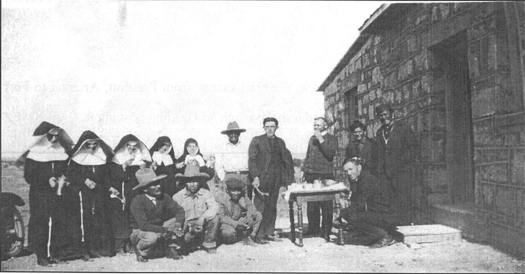 The rear of the church. If you look closely, the man on the far right is Nakai Chee, who donated the land the church is situated on. He died on July 27, 1958 and is buried on the property.