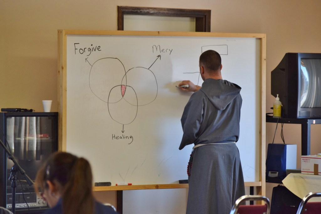 Fr. Ignatius Mazanowski, a Franciscan of the Holy Spirit from the Diocese of Phoenix, prepares his presentation at the Native American Ministry Inservice on November 19.