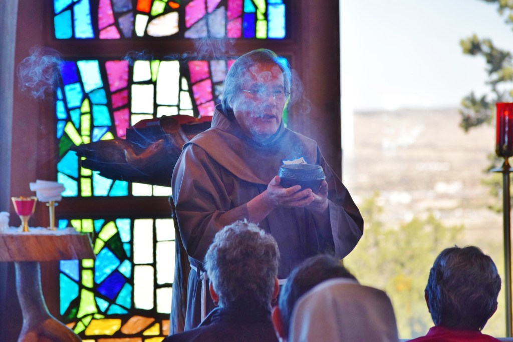 NAM-7: Br. Maynard Shurley, OFM, blesses the congregation prior to Mass in the Sacred Heart Retreat Center chapel during the Native American Ministry Inservice on November 19.